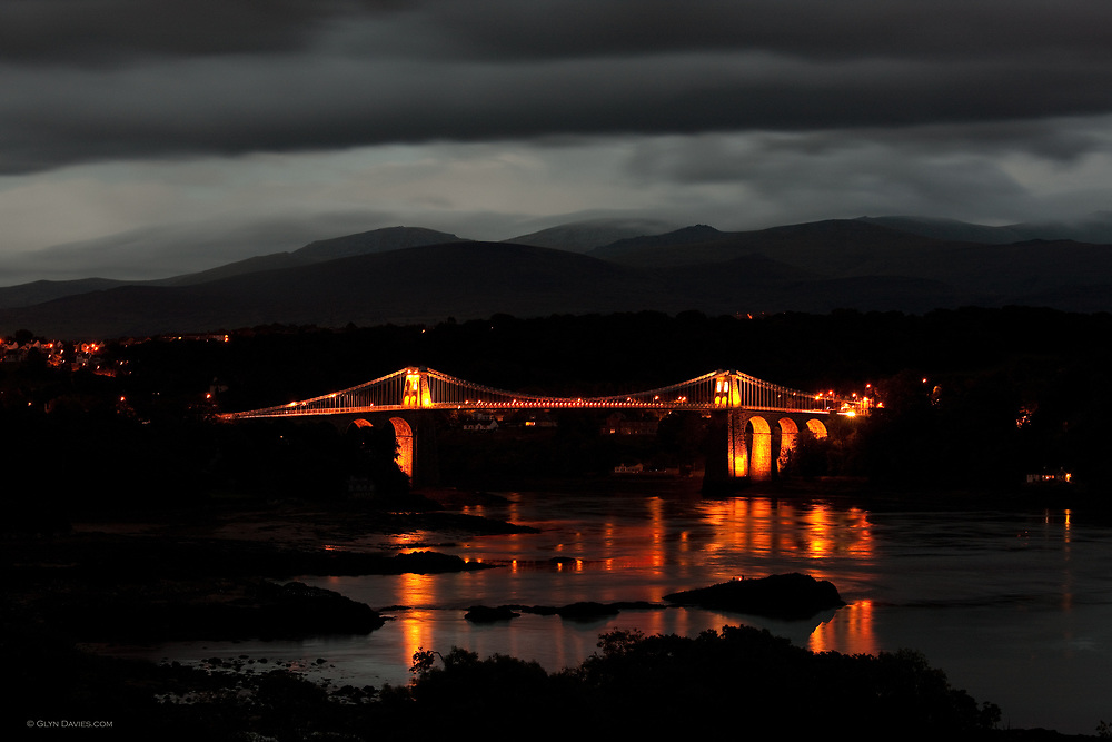 Menai Suspension Bridge (Welsh: Pont Grog y Borth) which is a stone built Victorian suspension bridge between the island of Anglesey and Bangor and mainland of Wales. The 100ft high bridge was designed by Thomas Telford and completed in 1826.