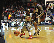 "Mississippi's Derrick Millinghaus (3) is defended by Mississippi State's Trivante Bloodman (4) at the C.M. ""Tad"" Smith Coliseum on Wednesday, February 6, 2013."