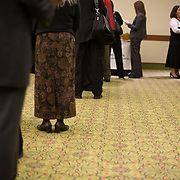Job seekers wait to speak to a temp staffing agency recruiter at a job fair at the Rosslyn Holiday Inn in Arlington, VA on Friday, Jan. 15, 2010.