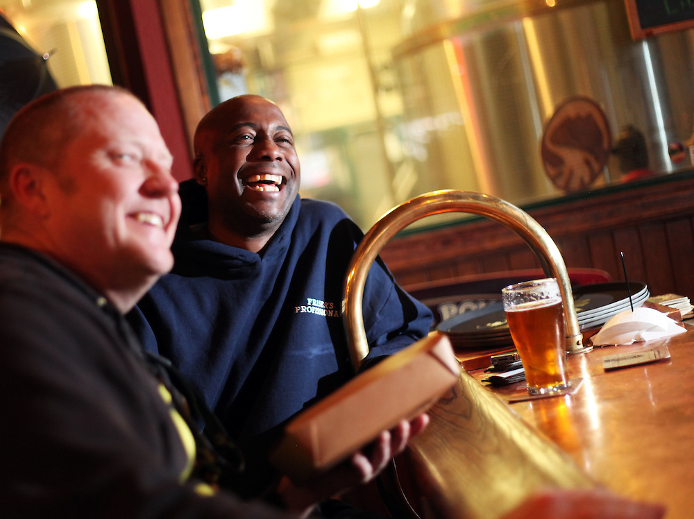 Jerry Christensen, left, and Ian Fraser enjoy an afternoon pint at the original bar at Deschutes Brewery. Craft beer permeates the culture in Central Oregon city of Bend, with 10 breweries serving pints, growlers and kegs to a community of less than 90,000. Photographed Wednesday, April 25, 2012. Assignment ID 30125094A