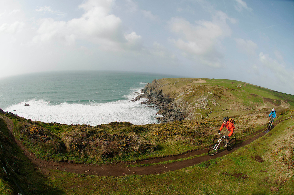 mountain biking the trails around Lands End and the Lizard Peninsula, Cornwall, England.