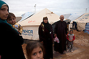 Syrian refugee Abu Moa'ad with wife and children  by their tent  at  the Za'atri Syrian refugee camp in northern Jordan February 5,2013. He fled with his family from Daraa, Syria after his son and daughter were killed by snipers .He was smuggled into Jordan by car and then by walking to the border ...Jordan announced on Tuesday that the number of Syrian refugees in the country is expected to exceed 700, 000 in 2013, the state-run Petra news agency reported. (Photo by Heidi Levine/Sipa Press).