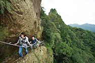 A hiking group descends the stairs a Xizozishan, near Pingxi, Taiwan.