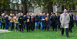 Westminster, London, October 14th 2015. Members of the FBU gather outside Parliament as they prepare to lobby MPs over cuts, the Trade Union Bill and the possibility of their service falling under the control of Police and Crime Commissioners. PICTURED:  FBU Secretary General Matt Wrack leads firefighters to Parliament.
