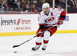 Oct 17, 2009; Newark, NJ, USA; Carolina Hurricanes left wing Ray Whitney (13) skates with the puck during the first period of their game against the Devils at the Prudential Center.