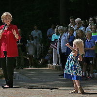 (Hanover, MA - 7/3/15) A young girl takes over the stage as presidential candidate and former Secretary of State Hillary Clinton speaks during a campaign rally at Dartmouth College, Friday, July 03, 2015. Staff photo by Angela Rowlings.