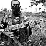 An AUC paramilitary fighter armed with a Kalashnikov assault weapon in a village near La Dorada, Putmayo.