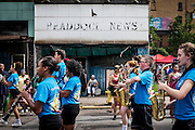 The marching band from nearby Woodland Hills High School passes in front of spectators near the former Braddock News building during the annual Community Day parade in Braddock, Pennsylvania, USA on August 13, 2016. <br /> <br /> Braddock High School closed in 1970.