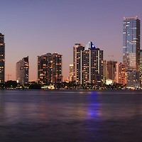 Panoramic view of buildings on Miami, Florida's Brickell Avenue and downtown skyline shortly after sunset.