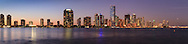 Panoramic view of buildings on Miami, Florida's Brickell Avenue and downtown skyline shortly after sunset.<br /> WATERMARKS WILL NOT APPEAR ON PRINTS OR LICENSED IMAGES.