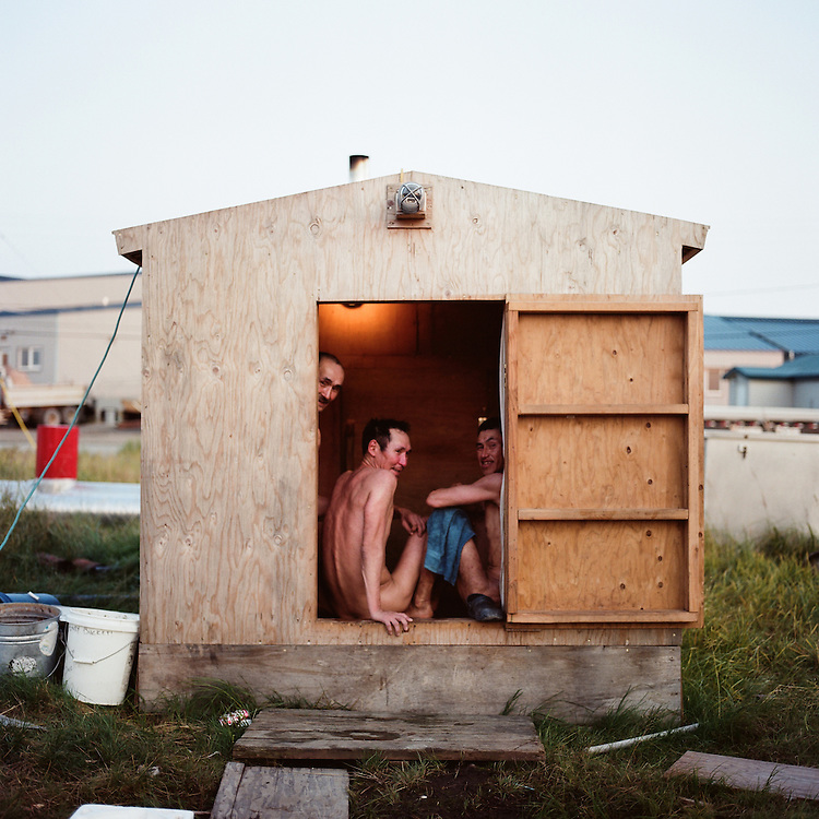 """We wash our bodies, try to wash the dirt off after we work out there. Relax and get clean I guess. It's called a steamhouse. We work all day and then this is where we come.""--Robert White (Right), William Sharp (Middle), John Sharp (Left), Quinhagak, Alaska"