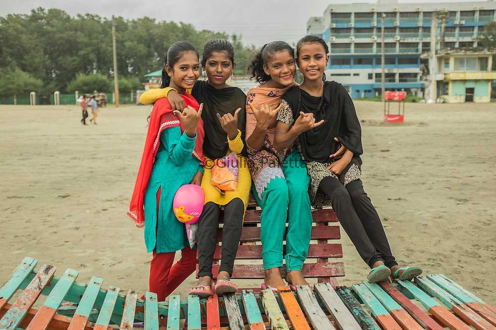 The surfer girls chilling on the beach of Cox's Bazar, Bangladesh