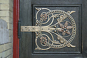 "Details of restored metalwork by Benham & Froud on a door of the old Abbey Mills Pumping Station (Station A). Located in Abbey Lane, London E15, the building is a sewerage pumping station, designed by engineer Joseph Bazalgette, Edmund Cooper, and architect Charles Driver, it was built between 1865 and 1868 after an outbreak of cholera in 1853 and ""The Big Stink"" of 1858. It was designed in a cruciform plan, with an elaborate Byzantine style, described as The Cathedral of Sewage. The pumps raise the sewage in the London sewerage system between the two Low Level Sewers and the Northern Outfall Sewer, which was built in the 1860s to carry the increasing amount of sewage produced in London away from the centre of the city."