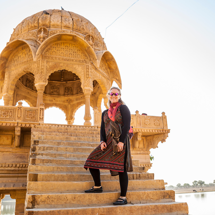 A woman posing for a picture while on travels in Jailsalmer, India.