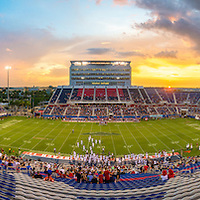 As the first half of play was winding down in the FAU v. SIU game, I saw an explosive sunset through one of the western facing tunnels, so I decided to skip the last few minutes of the second quarter to go to the top of the western facing stands to get the sunset over the stadium.<br /> <br /> Just as got almost to the top of the stands I saw the ball of the sun about to dip below the edge of the stadium and ran to the top and was able to grab this panorama with the sun in it.<br /> <br /> I tried to merge the panorama in the photo workroom after the game, but Lightroom had other plans..and it merged the field section perfectly...but it put both of the ends of the photo together..making for a very interesting concoction.