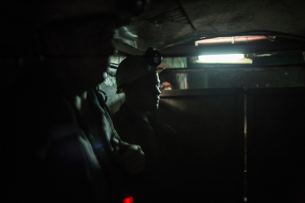 Miners ride the elevator down underground the Shcheglovskaya Coal Mine on Friday, March 25, 2016 in Makiivka, Ukraine.