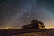 Orion and the Winter Milky Way over the grand old barn near home. Sirius and Canis Major are at left, Aldebaran and Taurus, with the Pleiades at upper right. A glow of Zodiacal Light shines to the west at right. <br /> <br /> Taken March 18, 2017 on a very clear night but with a gale force wind blowing from a Chinook wind, and with the warm day the fields were muddy and soft. As were the side roads. <br /> <br /> This is a stack of 8 x 30 second exposures for the ground (mean combined to smooth noise) and a single 30-second exposure for the sky. All at f/2.5 with the new Rokinon 14mm SP lens. And with the Canon 6D at ISO 3200.