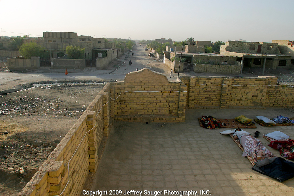 With daytime temperatures reaching 125-degrees Fahrenheit, sleeping outside on the roof is cooler during the extreme heat of August 2003 in Nasiriyah, Iraq.