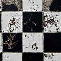 Black and white tiles damaged 20 years ago back in the riots of 1992 in South Los Angeles.