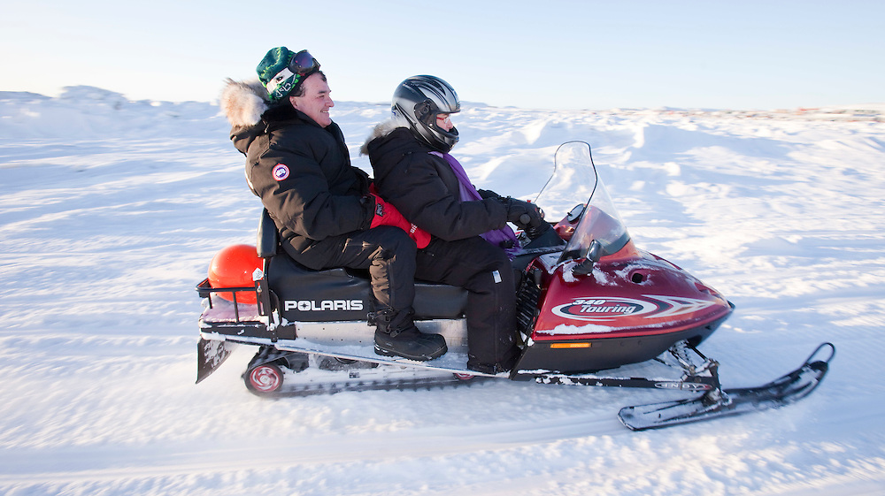 Canada's Finance Minister Jim Flaherty rides in a snowmobile across a frozen Frobisher Bay off Iqaluit, Nunavut, Canada, February 5, 2010 as Canada plays host to the G7 Finance Ministers in the northern community. <br /> AFP/GEOFF ROBINS/STR