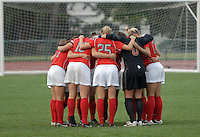 Members of the Ohio State soccer team huddle before Ohio State takes on the University of North Carolina in an NCAA women's college soccer game in Columbus, Ohio on Sunday, Sept. 4, 2011, at Jesse Owens Memorial Stadium.