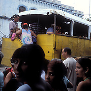 Bus stop in Pinar del Rio, Cuba with a typical public transport means, a wagon hauled by a truck.