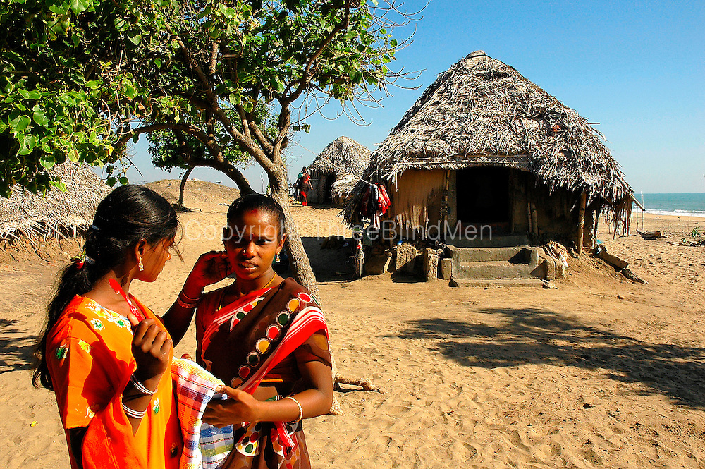 India. Young women on the beach at Akkampettai. A fishing village on the East Coast. Tamil Nadu. March 2005.