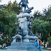 """A monument honors Ferdinand Magellan (1480-1521) in Punta Arenas, an important port city on the Strait of Magellan, in Chile, South America. Punta Arenas is the capital city of Chile's southernmost region, Magallanes and Antartica Chilena. Ferdinand Magellan (Spanish: Fernando de Magallanes, Portuguese: Fernão de Magalhães) was a Portuguese explorer who served King Charles I of Spain in search of a westward route to the """"Spice Islands"""" (modern Maluku Islands in Indonesia). Magellan's expedition of 1519-1522 was the first expedition to sail from the Atlantic Ocean into and across the Pacific Ocean and first to circumnavigate the Earth. Magellan himself did not complete the entire voyage, as he was killed in the Battle of Mactan in the Philippines. The foot of South America is known as Patagonia, a name derived from coastal giants, Patagão or Patagoni, who were reported by Magellan's 1520s voyage circumnavigating the world and were actually Tehuelche native people who averaged 25 cm (or 10 inches) taller than the Spaniards."""