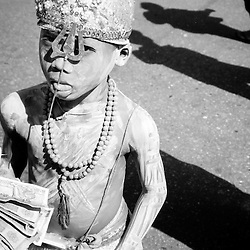 BURMA (MYANMAR) Yangon Division, Yangon, 2003. On the streets of Burma's capital city, Shiva's trident helps a young Hindu boy survive. Yangon receives from the government only a fraction of the electricity it needs to function.