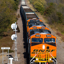 Moving westbound empty coal hoppers back to the mine, a BNSF train rolls down the single track outside of Creston, IA.