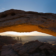"Mesa Arch glows at sunrise in Canyonlands National Park, Utah in 2006. Panorama stitched from five images. Published in ""Light Travel: Photography on the Go"" book by Tom Dempsey 2009, 2010."
