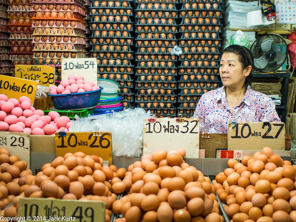 09 DECEMBER 2014 - THONBURI, BANGKOK, THAILAND:  An egg seller in her stall in a market in the Thonburi section of Bangkok.   PHOTO BY JACK KURTZ