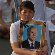 A mourner holds a portrait of former Cambodian King Norodom Sihanouk prior to funeral services Friday Feb. 1, 2013 in Phnom Penh, Cambodia.  The cremation of the former king is set for Feb. 4, 2013.  Sihanouk died last October 15, 2012, in Beijing, China.  He was 89 years old.
