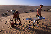 Extreme housework in the Sahara Desert after a hard days drive.. In Mauritania
