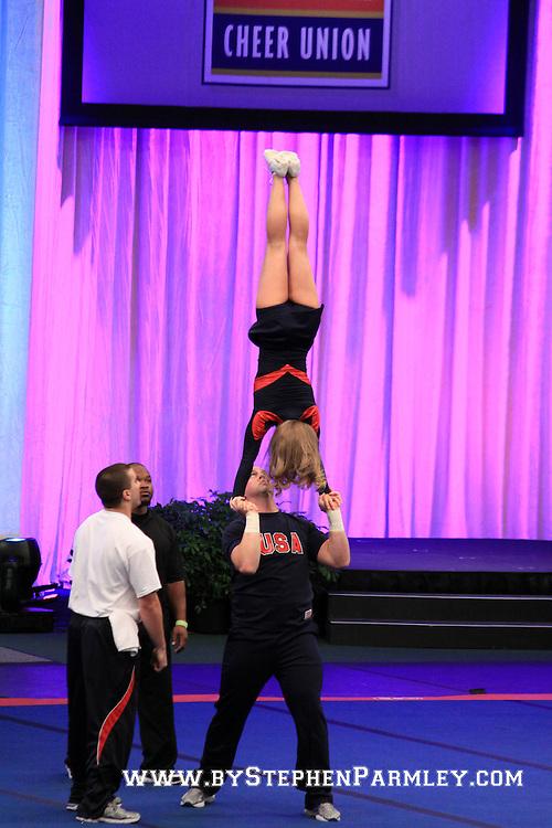 Team USA Partner stunt at ICU Worlds. Hands in hands pop around to post.