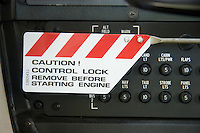 """Control lock warning sign on a Cessna 172: """"Caution! Control Lock - remove before starting engine"""""""