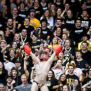 SHOT 2/14/13 9:22:16 PM - A Colorado basketball fan strips down to a speedo and dances in an attempt to distract an Arizona player shooting a free throw during their regular season Pac-12 basketball game at the Coors Event Center on the Colorado campus in Boulder, Co. Colorado won the game 71-58. The student cheering section is nicknamed the C-Unit. (Photo by Marc Piscotty / © 2013)