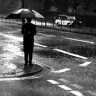 Man waiting for a Taxi in the Rain, Hyde Park Corner, London, Britain - 2007.