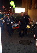 Police bring body of an unidentified male struck and killed by a south-bound #6 train at apprx 920 PM on August 20, 2009