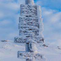 A frozen sign at Ulriken