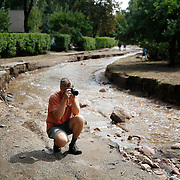 BOULDER, CO - SEPTEMBER 13: Jake Pommer of Boulder, Colorado takes pictures along what remains of Topaz Street as heavy rains fueled widespread flooding in numerous Colorado towns on September 13, 2013. Pommer lives close by and wanted to see the damage first hand.(Photo by Marc Piscotty/ © 2013)