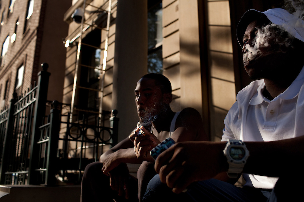 Jay Jefferson, 18, and Benny Brown, 20, smoking on 159th Street in Sugar Hill on June 23, 2012.