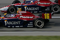 Danica Patrick and Buddy Rice race at the Kentucky Speedway, Kentucky Indy 300, August 14, 2005