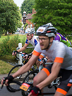 Cyclists ride through the Surrey countryside at Abinger Hammer during the Prudential RideLondon-Surrey 100, Sunday 2nd August 2015. <br /> <br /> Prudential RideLondon is the world&rsquo;s greatest festival of cycling, involving 95,000+ cyclists &ndash; from Olympic champions to a free family fun ride - riding in five events over closed roads in London and Surrey over the weekend of 1st and 2nd August 2015. <br /> <br /> Photo: Christopher Ison for Prudential RideLondon<br /> <br /> See www.PrudentialRideLondon.co.uk for more.<br /> <br /> For further information: Penny Dain 07799 170433<br /> pennyd@ridelondon.co.uk