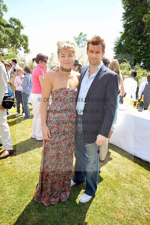 TOM & AMBER AITKENS at a luncheon hosted by Cartier for their sponsorship of the Style et Luxe part of the Goodwood Festival of Speed at Goodwood House, West Sussex on 5th July 2009.