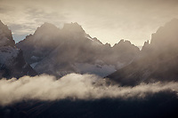 Clouds lifting off the rugged summit of Trono Blanco in Torres del Paine, Chile