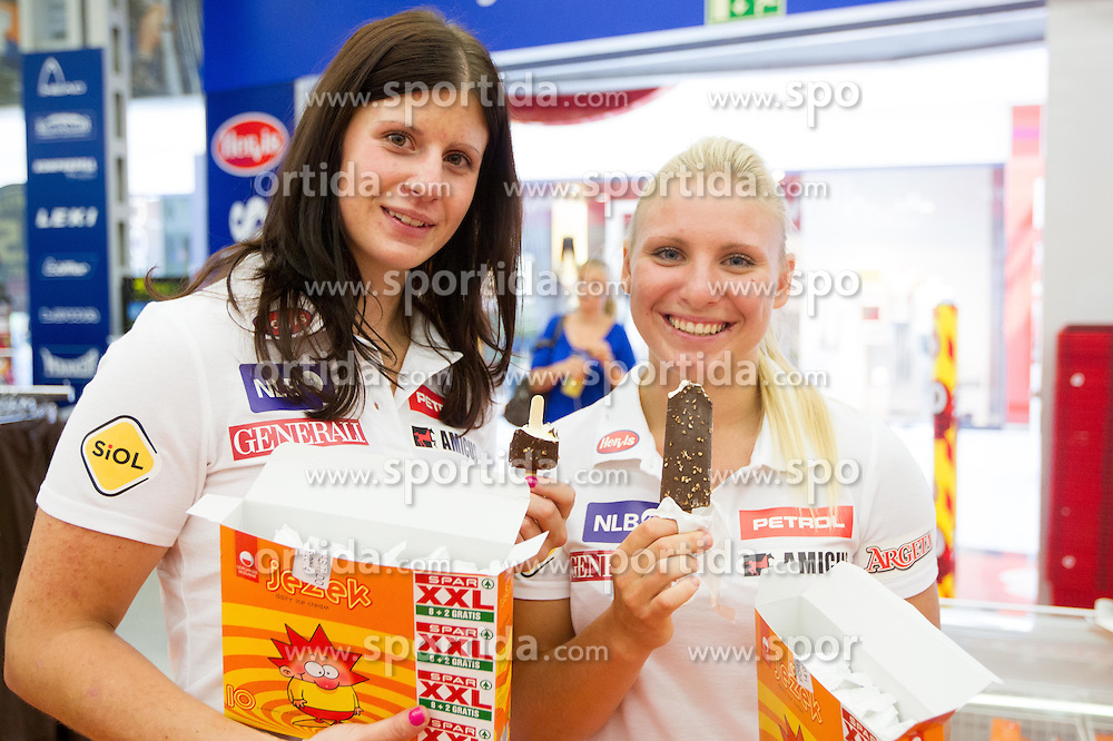 Ula Hafner and Katja Horvat with ice cream Jezek during press conference of Slovenian Alpine Ski team before training camp in South America, on August 21, 2012 in BTC - City Park, Ljubljana, Slovenia. (Photo by Vid Ponikvar / Sportida.com)