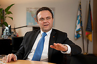 03 JAN 2011, BERLIN/GERMANY:<br /> Hans-Peter Friedrich, MdB, CSU, Vorsitzender der CSU Landesgruppe im Deutschen Bundestag, waehrend einem Interview, in seinem Buero, Jakob-Kaiser-Haus, Deutscher Bundestag<br /> IMAGE: 20110103-01-042