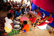 Indian Christians pray during Good Friday services at a camp for displaced Christians April 10, 2009 in the town of Mondesore in the state of Orissa, India. Tensions remain high in the area several months after violence by Hindu fundamentalist towards the Christian minority  forced thousands from their homes and leaving several churches and homes destroyed.