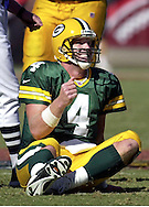 (2000)- Green Bay's Brett Favre smiles after sliding for a short gain after keeping the ball on a pass attempt.